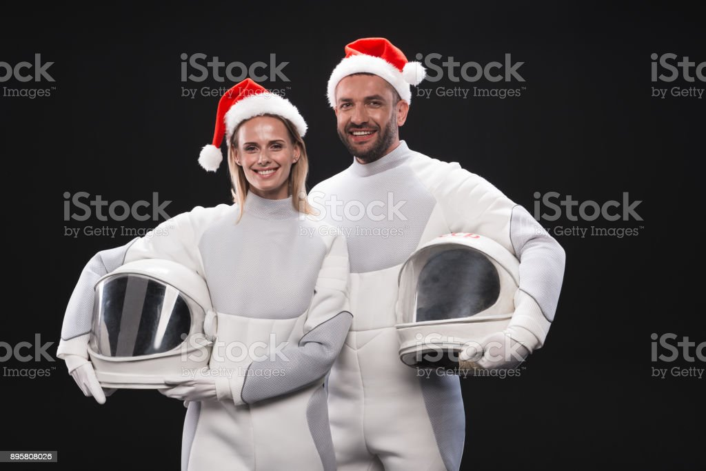 Delighted couple of cosmonauts are expressing amorousness stock photo