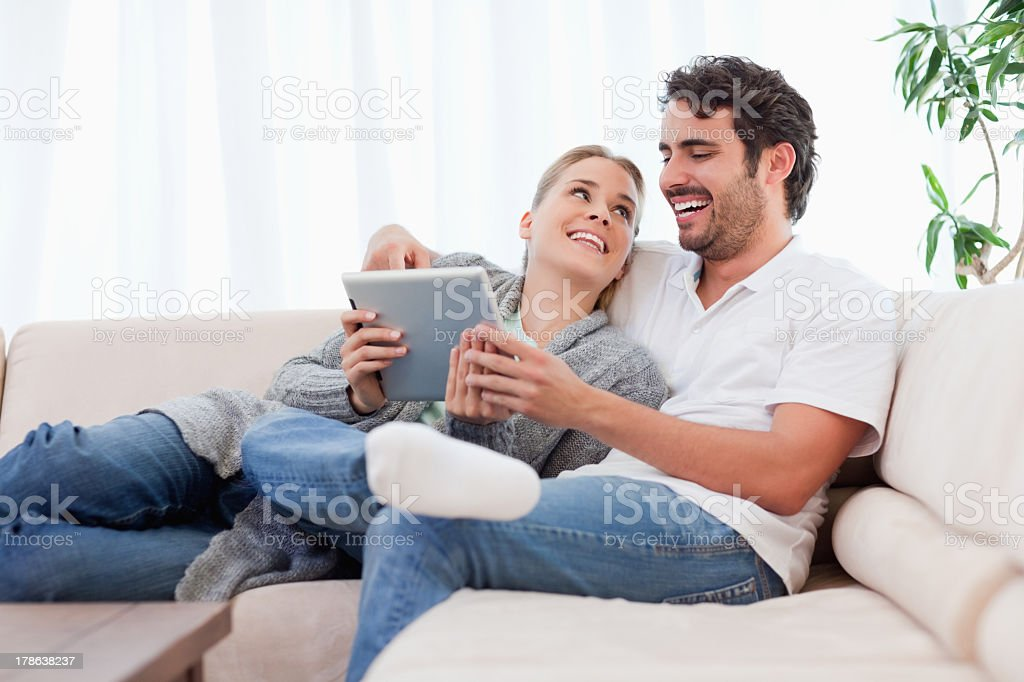 Delighted couple using a tablet computer royalty-free stock photo