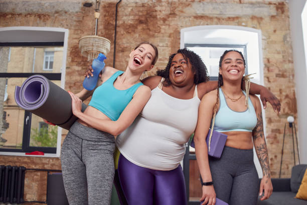 Delighted females having fun before home training stock photo
