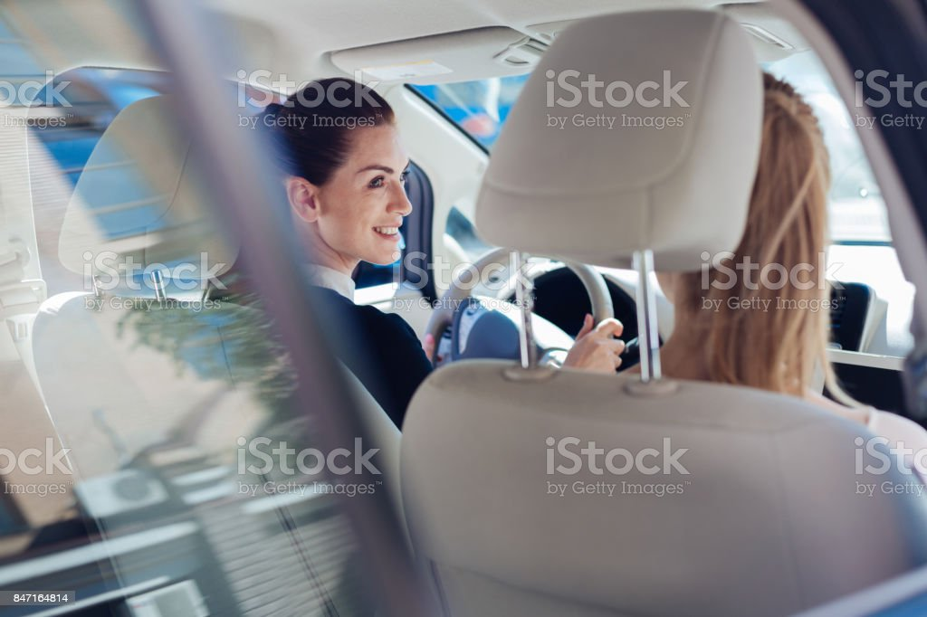 Delighted happy women looking at each other stock photo