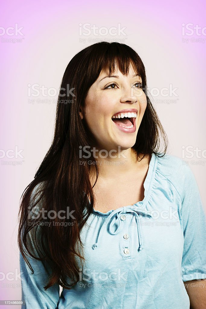 Delighted long-haired brunette smiles to the side royalty-free stock photo