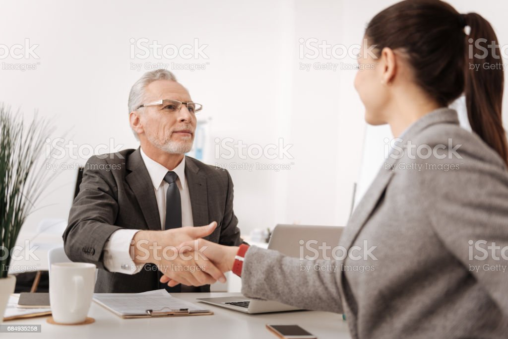 Delighted man and woman shaking hands Lizenzfreies stock-foto