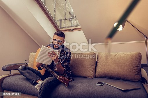 istock Delighted positive man holding his note charts 1098012096