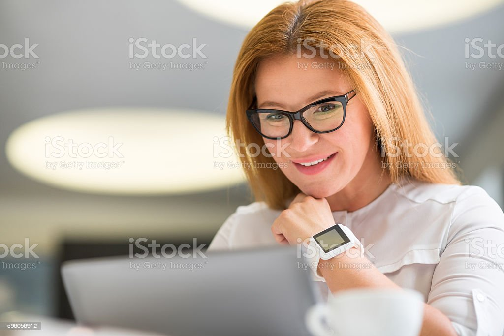 Delighted senior woman using tablet royalty-free stock photo