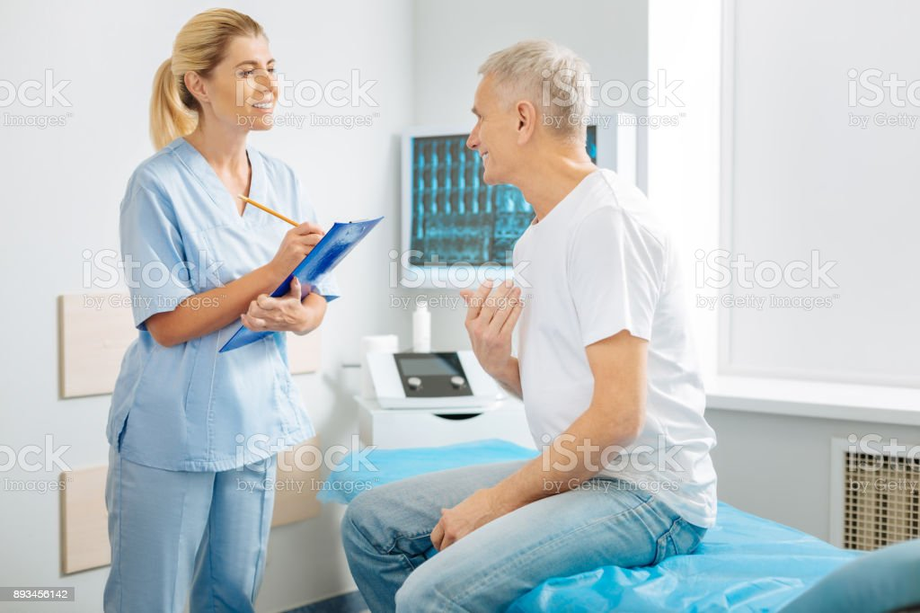 Delighted smart doctor being ready to listen stock photo