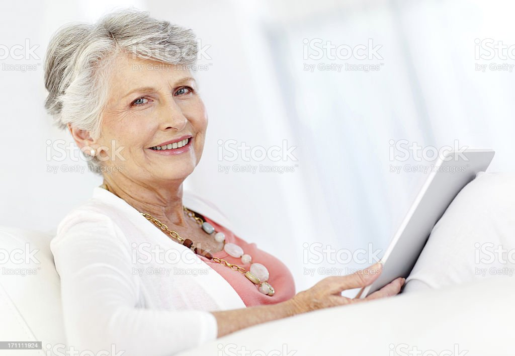 Delighted, tech-savvy senior royalty-free stock photo