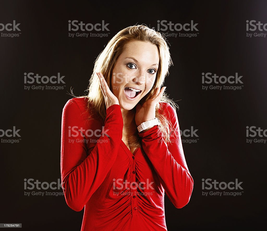 Delighted young blonde woman gets a wonderful surprise stock photo
