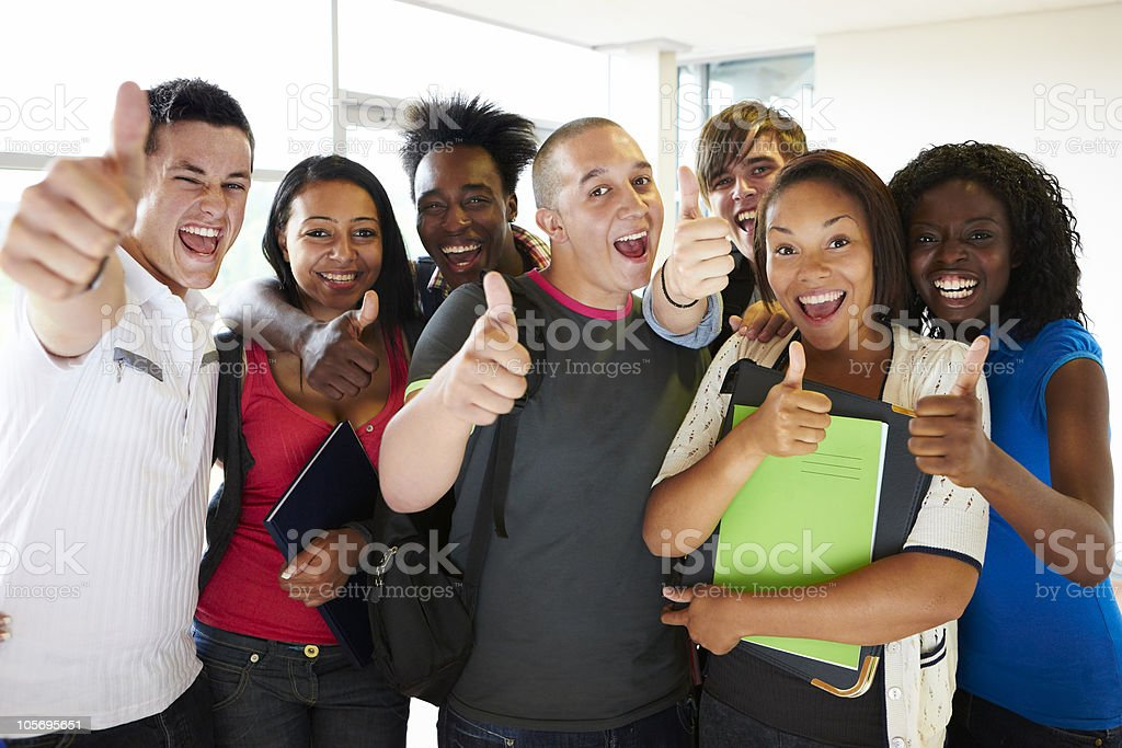 delighted young students making a thumbs up sign royalty-free stock photo