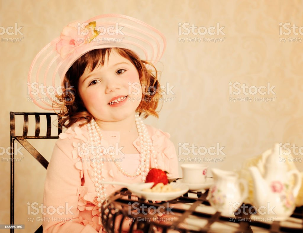 Delightful Little Girl Tea Partying stock photo