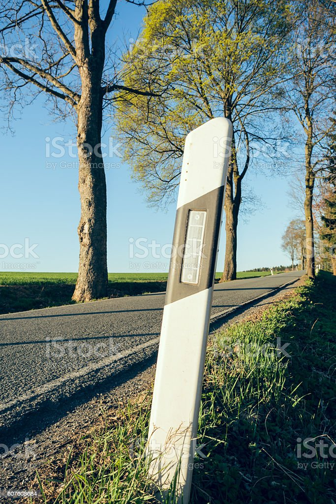 delineator on an empty country road stock photo