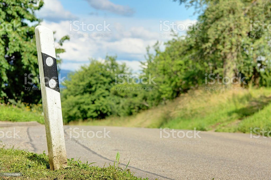 delineator / reflector post on a road stock photo