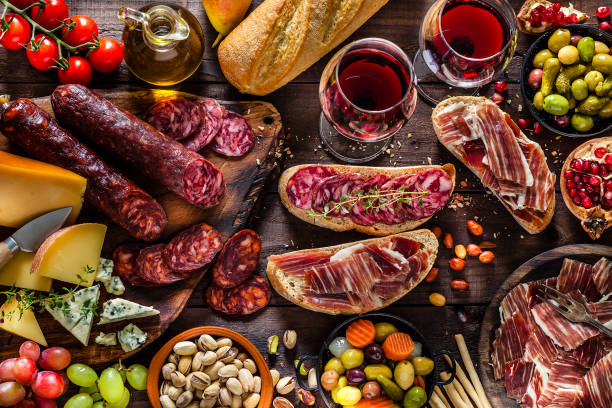 deliscious appetizer on rustic wood table - spanish food stock photos and pictures