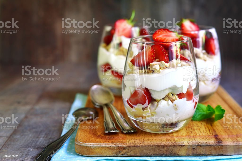 Delisious traditional english dessert eton mess with strawberry on a...