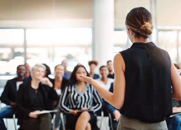 Delivering an informative presentation like a pro Shot of a young businesswoman delivering a speech during a conference event stock pictures, royalty-free photos & images