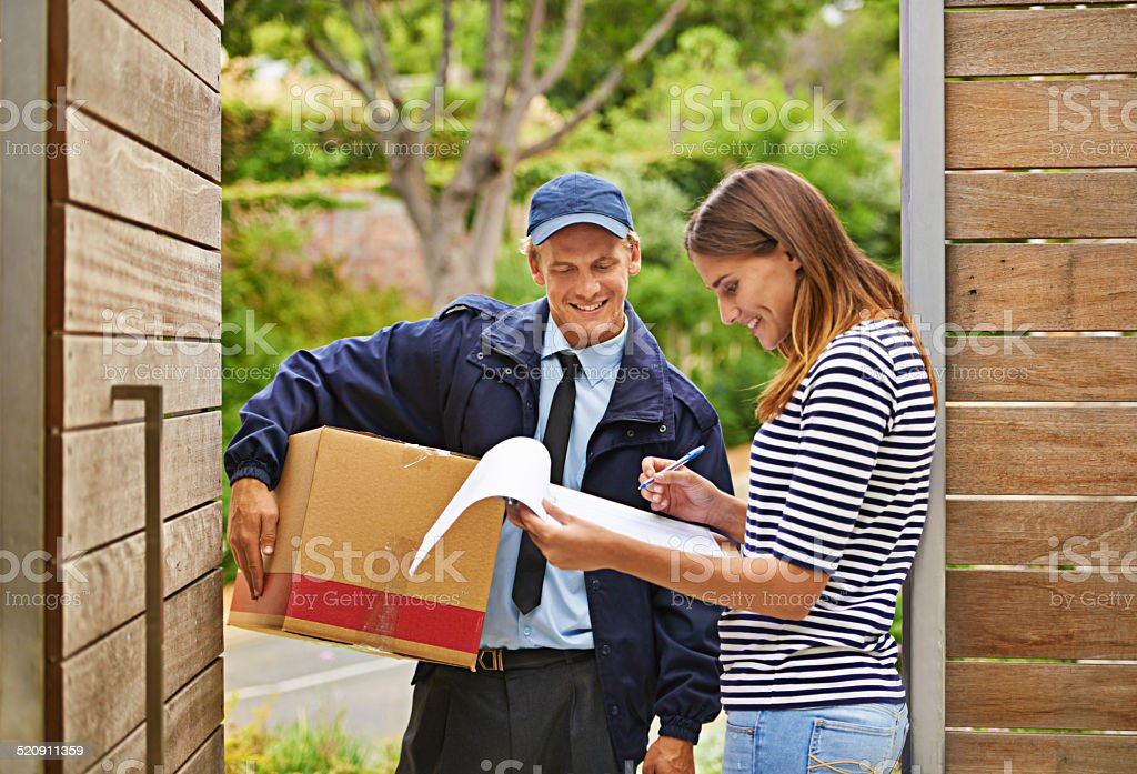 Delivering each package with a smile stock photo