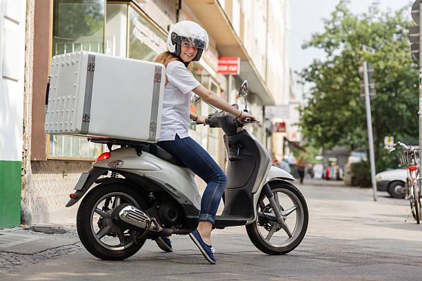 Delivering fast food on Motor scooter