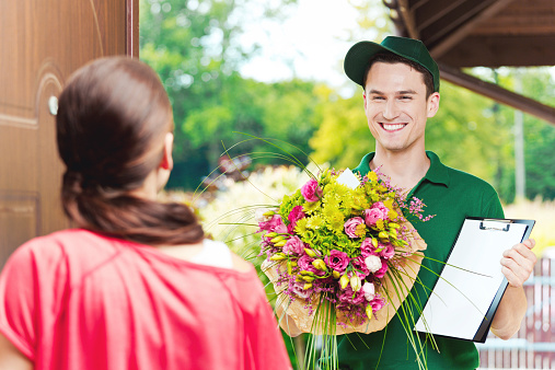 Delivering Flowers Stock Photo - Download Image Now