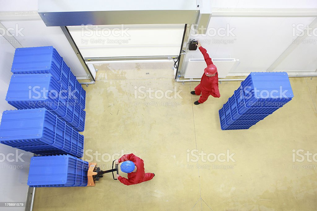 delivering goods, opening gate to storehouse royalty-free stock photo
