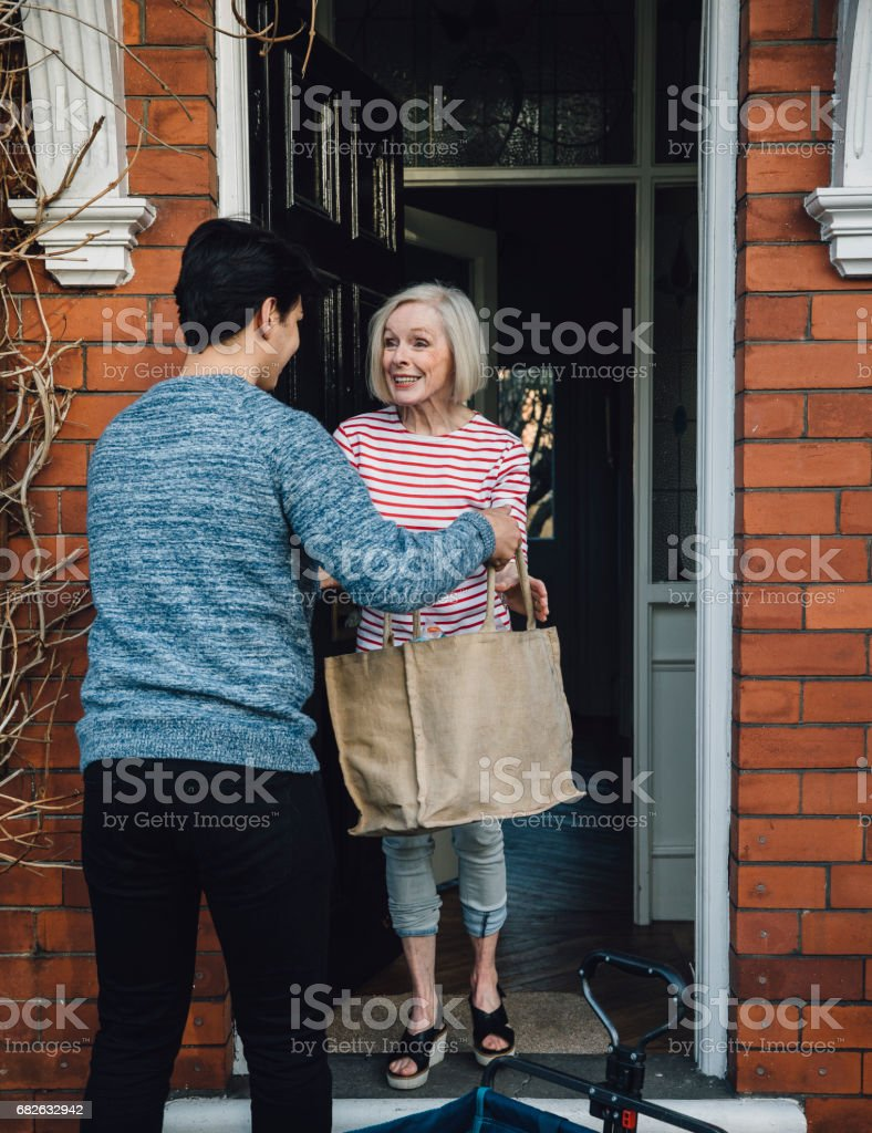 Delivering Groceries To The Elderly stock photo