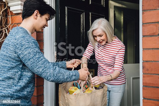 istock Delivering Groceries To The Elderly 682632944