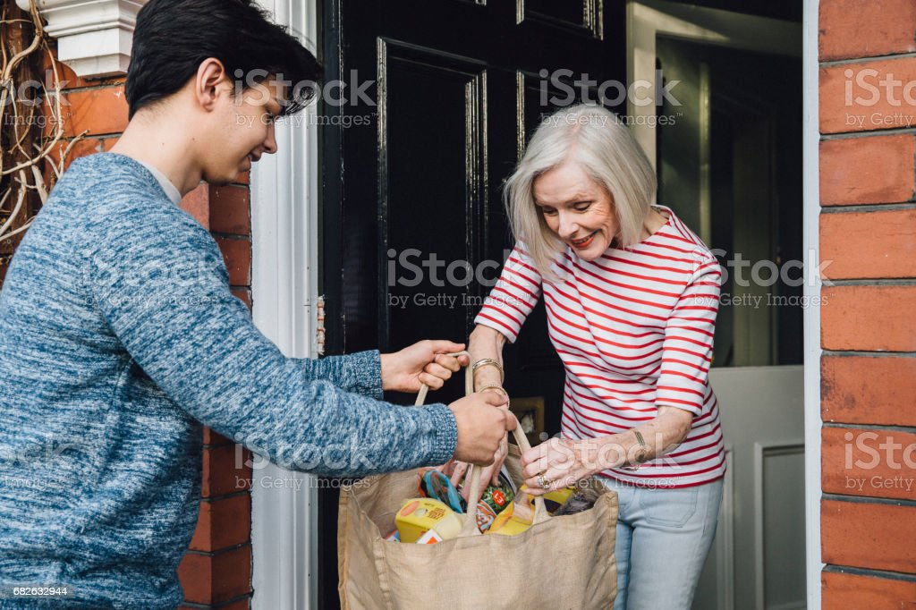 Delivering Groceries To The Elderly - foto de acervo