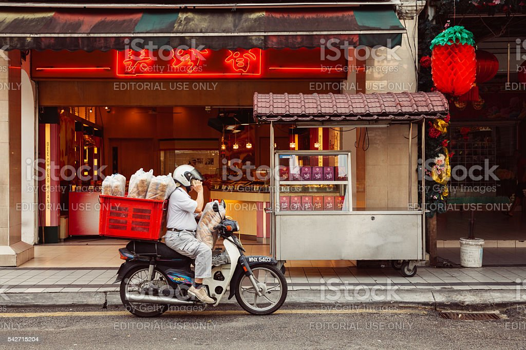 Delivering noodles to Chinese restaurant, Kuala Lumpur, Malaysia stock photo