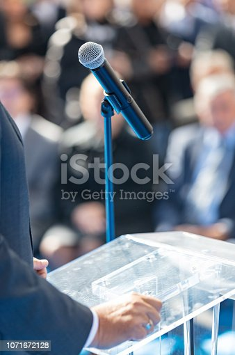 854811490 istock photo Delivering speech to audience 1071672128
