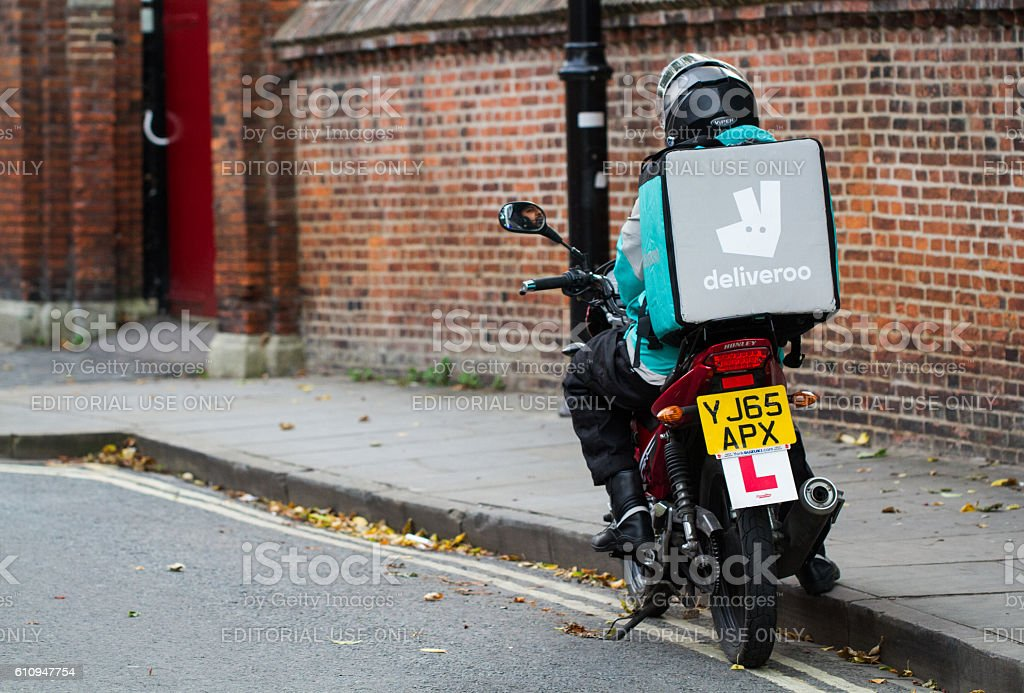 Deliveroo Motorcycle Delivery Driver stock photo