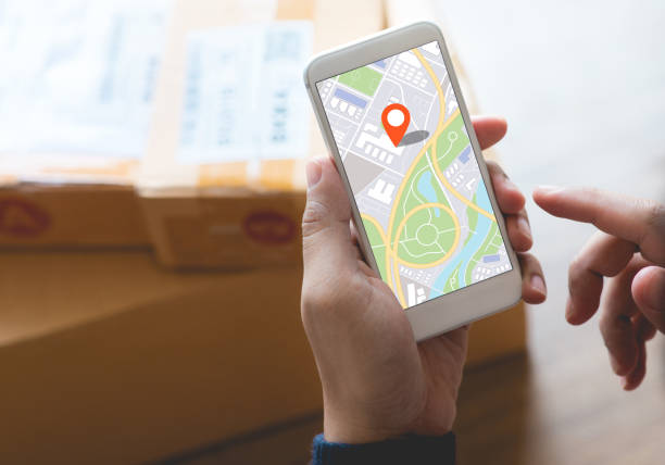 Delivery and online shopping concepts with young person using digital map with smartphone on product package box.Ecommerce market.Transportation logistic stock photo