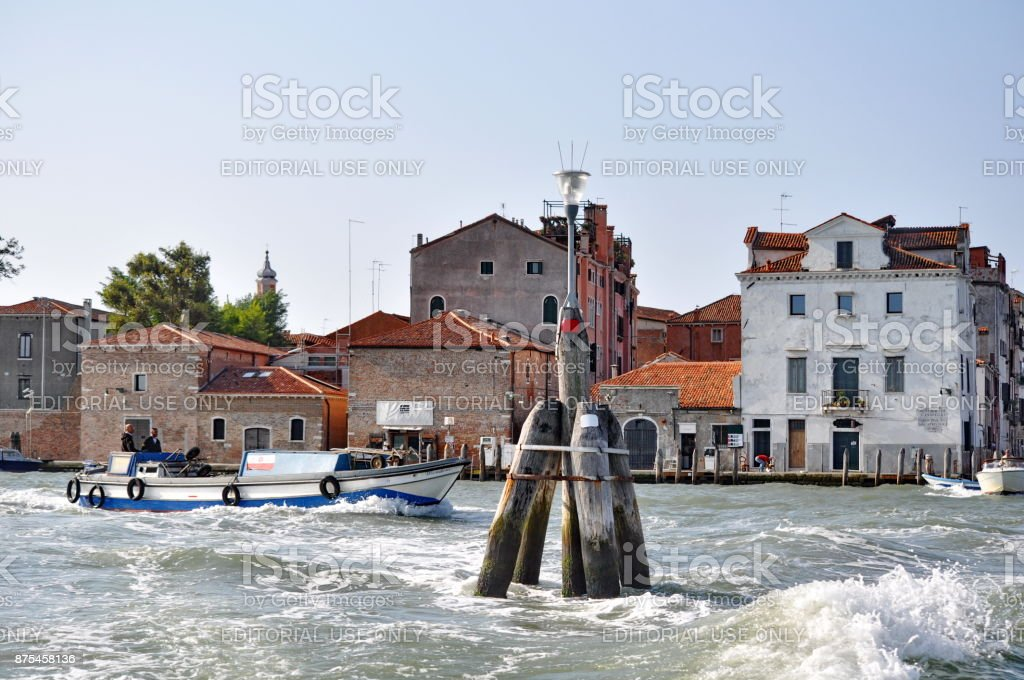 Delivery boat on the Grand Canal in Venice, Italy stock photo