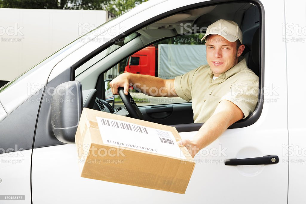 delivery boy handing you a parcel royalty-free stock photo