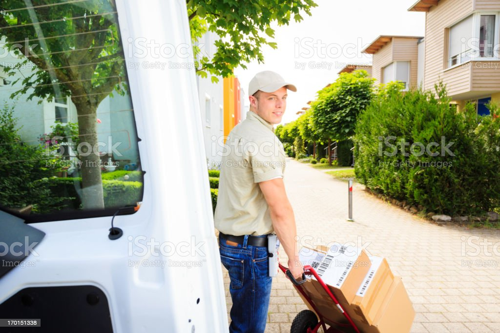 delivery boy in residential area royalty-free stock photo
