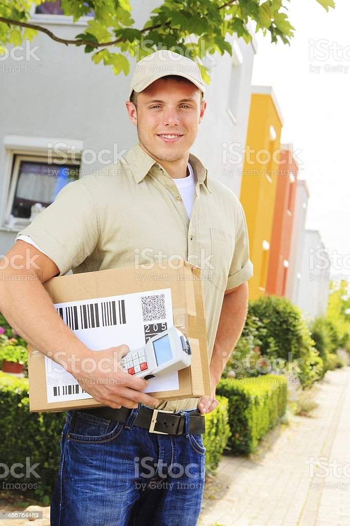 delivery boy in residential area stock photo