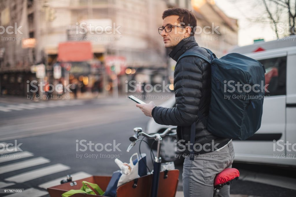 Delivery boy looking for the right direction stock photo