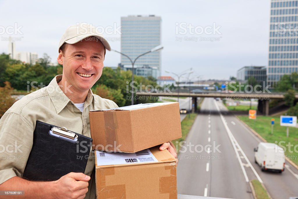 delivery boy standing on a bridge royalty-free stock photo