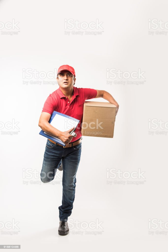 Delivery Concept - Portrait of Happy Indian or delivery man in red or...