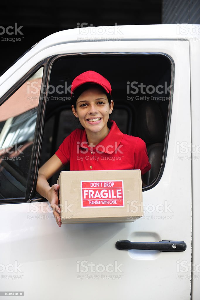 delivery courier in truck handing over package royalty-free stock photo