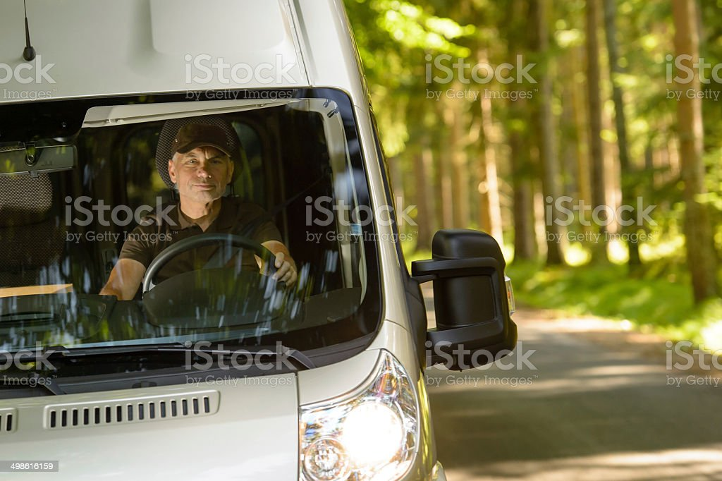 Delivery courier in van on the way stock photo