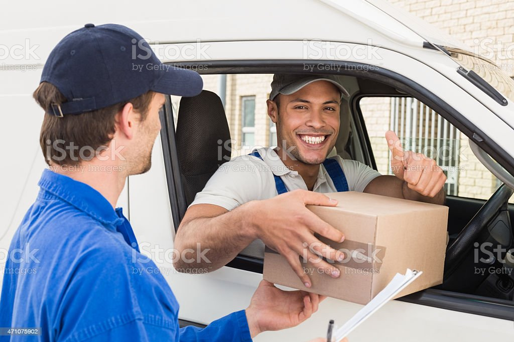 Royalty Free Delivery Driver Handing Parcel To Customer In His Van ...