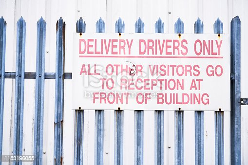 Delivery drivers and visitors go to reception sign uk