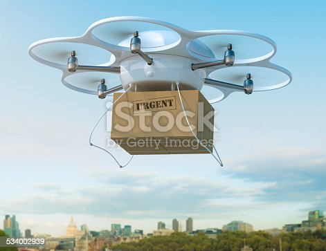 istock Delivery drone carrying urgent shipment box in a city. 534002939