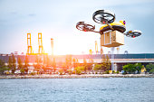 Delivery drone delivering petrochemical product from oil refinery for shipping fine and crude oil to drilling platforms or customer. Modern innovative technology and security gadget. Unmanned drone