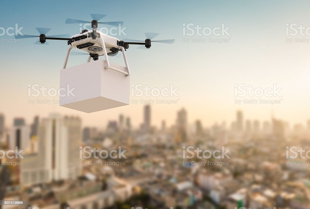 delivery drone flying in city stock photo