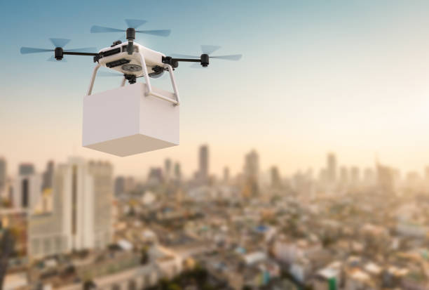 delivery drone flying in city - drones stock photos and pictures