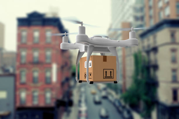 delivery drone flying in city - drones stock pictures, royalty-free photos & images