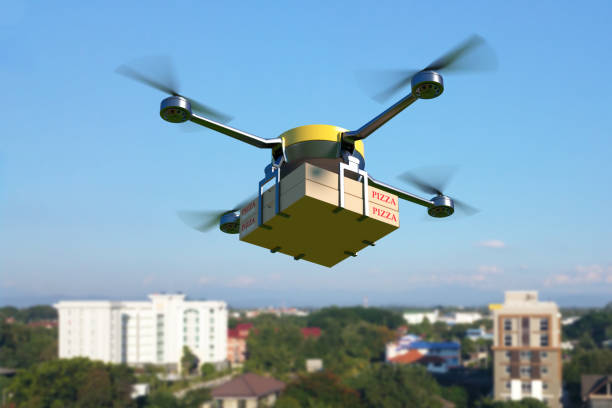 drone de entrega com caixa de pizza. - drone - fotografias e filmes do acervo