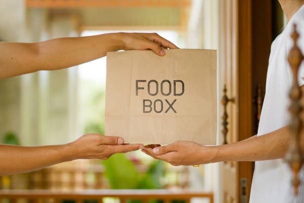 Delivery food box to front door stock photo