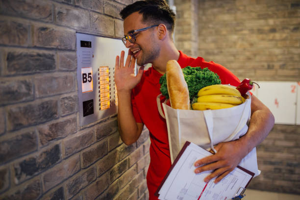 Delivery man at the front door of his customer stock photo