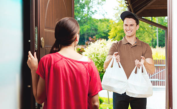 Delivery man delivering chinese take away food stock photo