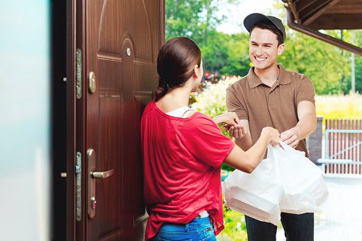 Delivery Man Delivering Chinese Take Away Food Stock Photo - Download Image Now